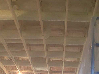 2lb-foam-sprayed-on-round-ducts-in-attic